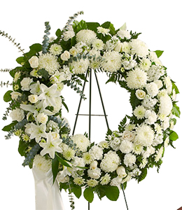 White_funeral_wreath_at_Scent_and_Violet_florist.jpg