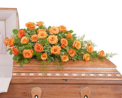 Orange Rose casket spray in Houston, TX